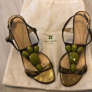 Kate Spade gold sandals with green stones.